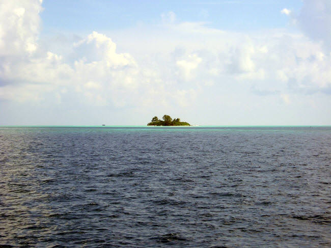 From the ship anchorage, the island is a tiny dot in a huge lagoon. (Caspar Henderson)
