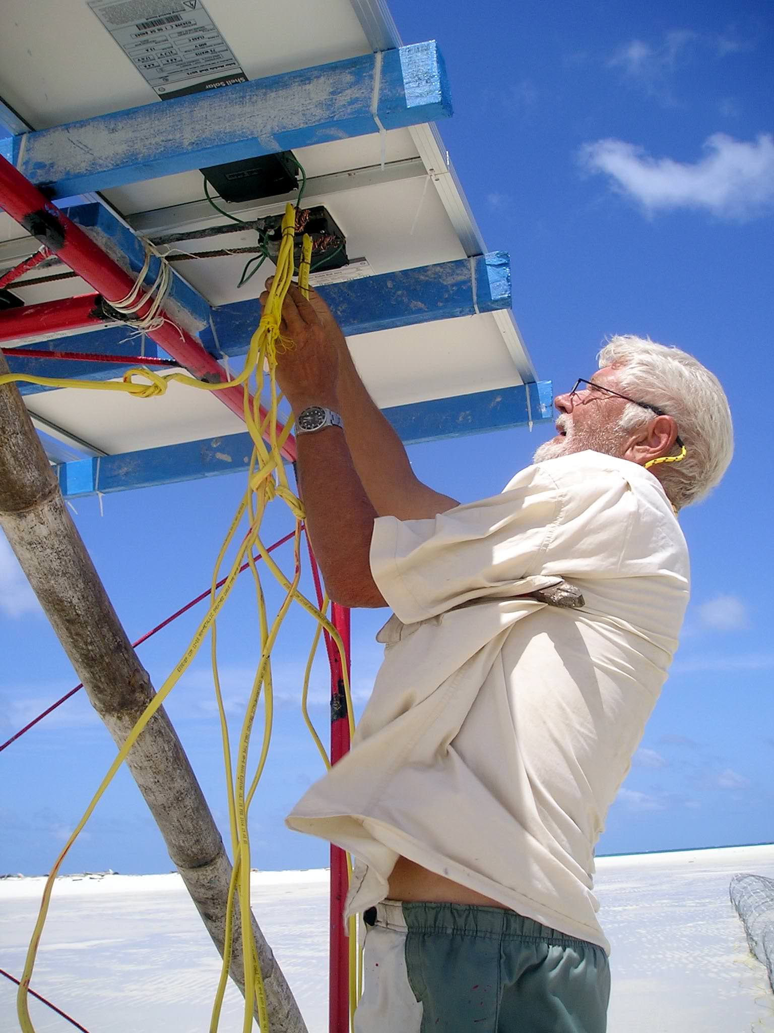 Wiring the panel connections to the structure. (Caspar Henderson)